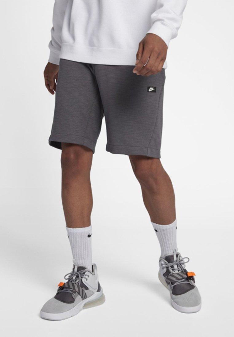 Nike Sportswear - OPTIC - Tracksuit bottoms - dark grey/heather