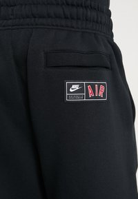 Nike Sportswear - AIR - Tracksuit bottoms - black/university red/sail - 6