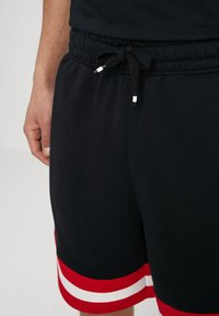 Nike Sportswear - AIR - Tracksuit bottoms - black/university red/sail - 3