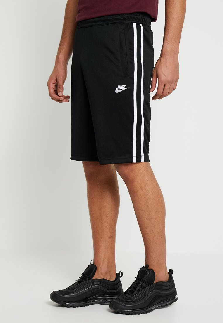 Nike Sportswear - TRIBUTE  - Tracksuit bottoms - black/white
