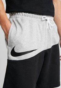 Nike Sportswear - Tracksuit bottoms - mottled dark grey - 4
