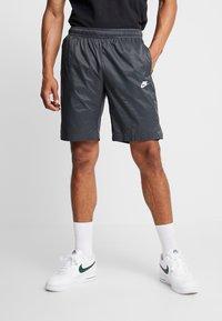 Nike Sportswear - CORE  - Träningsbyxor - black - 0
