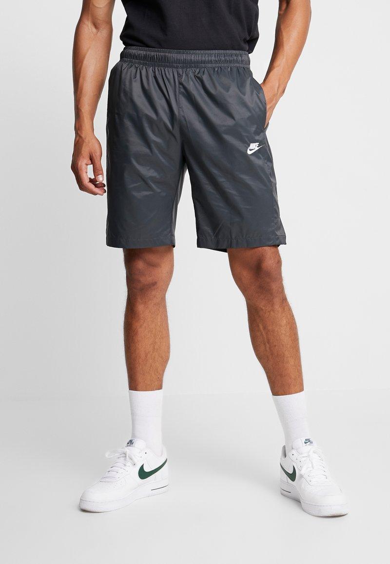Nike Sportswear - CORE  - Tracksuit bottoms - black