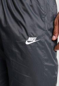 Nike Sportswear - CORE  - Träningsbyxor - black - 4