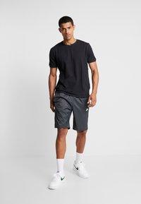 Nike Sportswear - CORE  - Träningsbyxor - black - 1