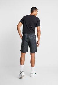 Nike Sportswear - CORE  - Träningsbyxor - black - 2