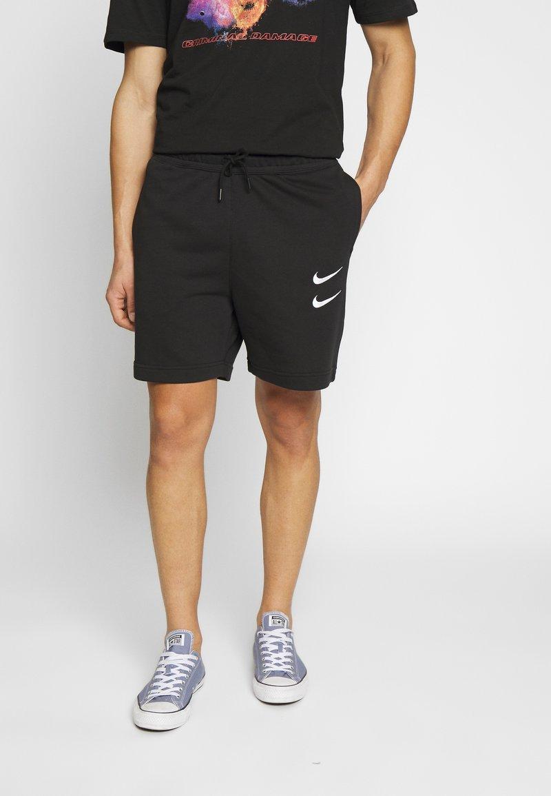Nike Sportswear - Teplákové kalhoty - black/white