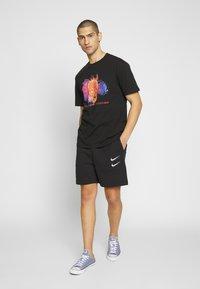 Nike Sportswear - Træningsbukser - black/white - 1