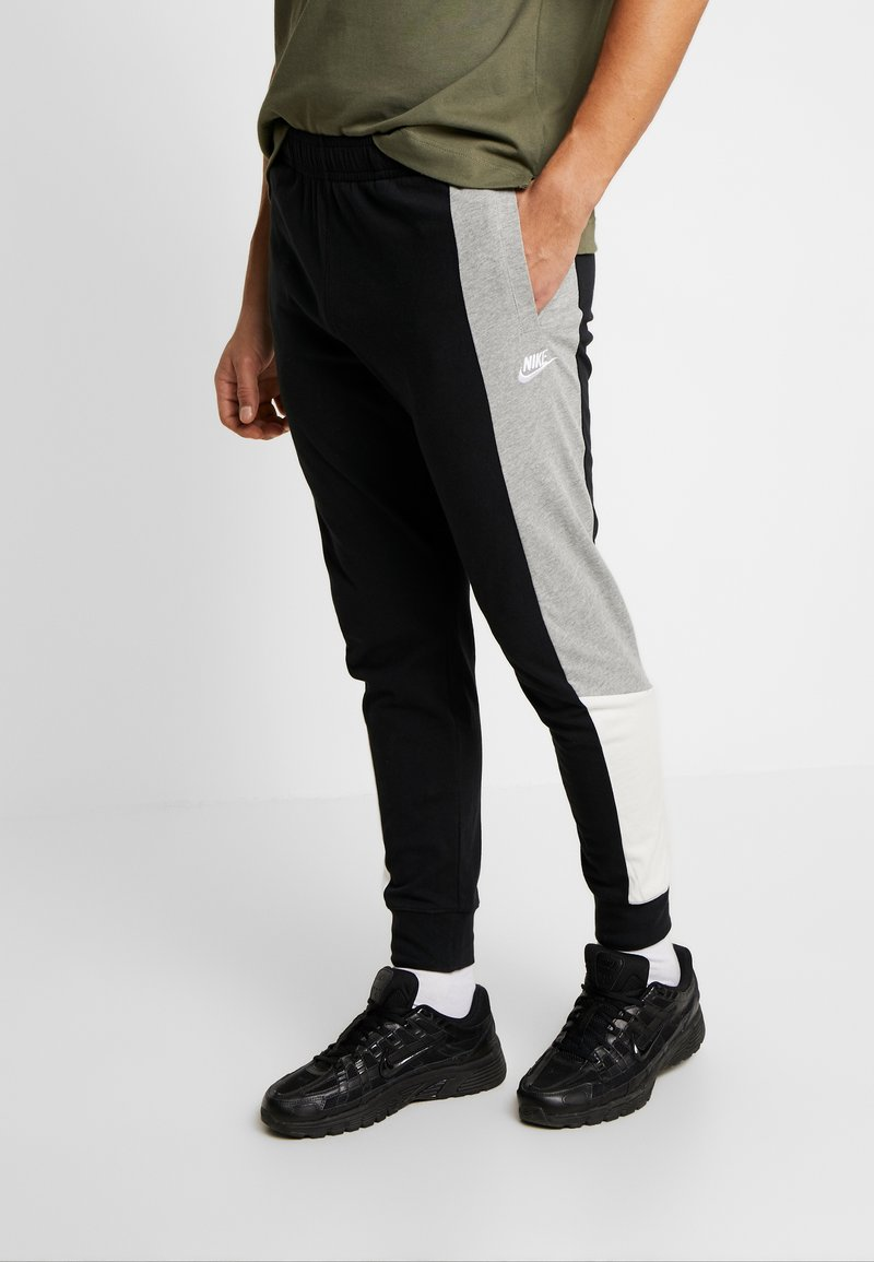 Nike Sportswear - Tracksuit bottoms - black/grey heather