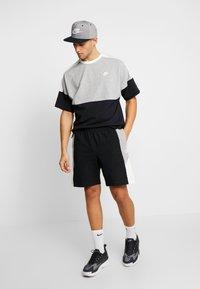 Nike Sportswear - M NSW SHORT JSY CB - Short - black/grey heather - 1