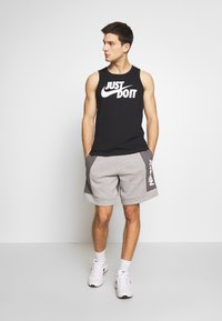 Nike Sportswear - AIR - Trainingsbroek - grey/charcoal - 1