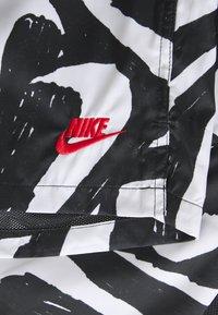 Nike Sportswear - FLOW - Shorts - black - 2