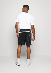 Nike Sportswear - Tracksuit bottoms - black/white - 2