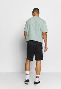 Nike Sportswear - M NSW SHORT PK - Short - black/white - 2