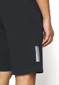 Nike Sportswear - Tracksuit bottoms - black - 5