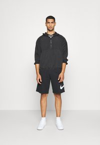 Nike Sportswear - Tracksuit bottoms - black - 1