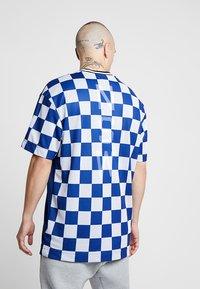 Nike Sportswear - TOP CHECK - T-Shirt print - blue void/royal blue/white - 2