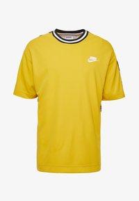 yellow ochre/black/white