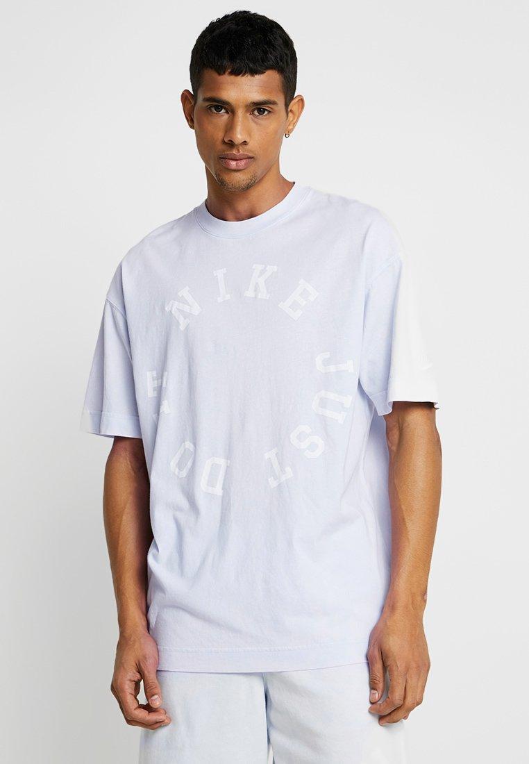 Nike Sportswear - TOP WASH - Print T-shirt - half blue