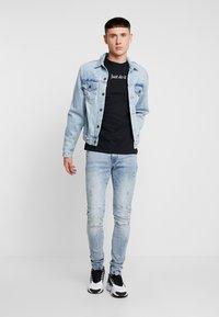 Nike Sportswear - TEE - Camiseta estampada - black - 1