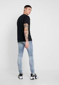 Nike Sportswear - TEE - Camiseta estampada - black - 2