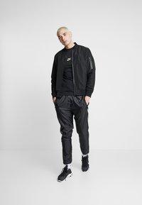 Nike Sportswear - T-shirt imprimé - black - 1