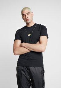 Nike Sportswear - T-shirt imprimé - black - 0