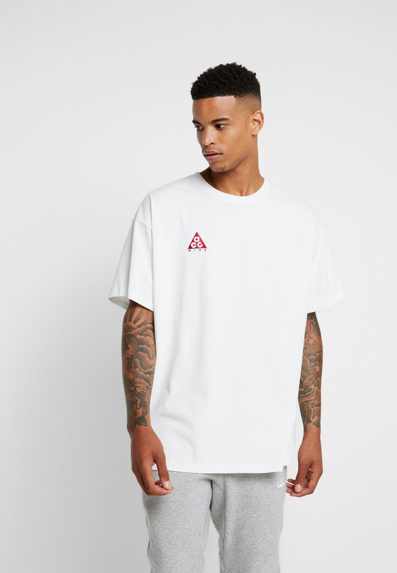 Nike Sportswear - TEE LOGO - Camiseta estampada - off-white