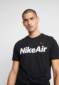 Nike Sportswear - AIR TEE - Print T-shirt - black/university red - 3