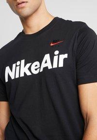 Nike Sportswear - AIR TEE - Print T-shirt - black/university red - 5