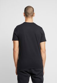 Nike Sportswear - AIR TEE - Print T-shirt - black/university red - 2