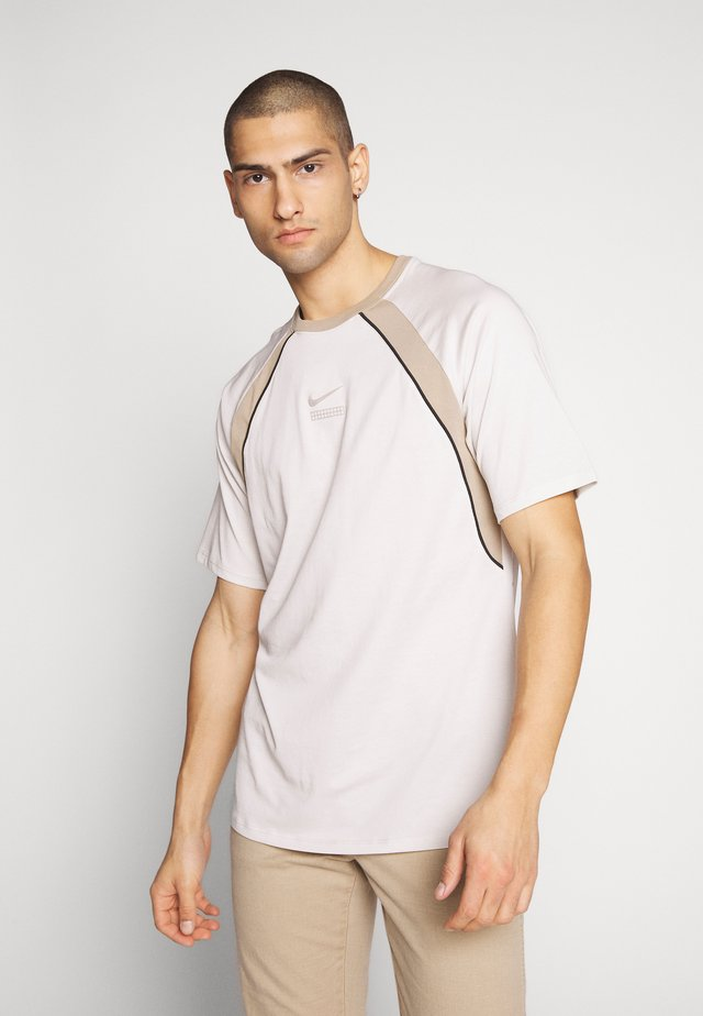 DNA - T-shirt con stampa - light bone/khaki