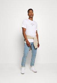 Nike Sportswear - TEE - Print T-shirt - white/black - 1