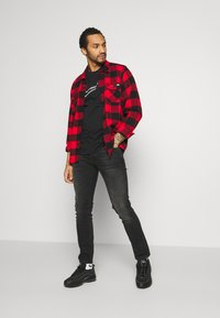 Nike Sportswear - TEE - T-shirt print - black - 1