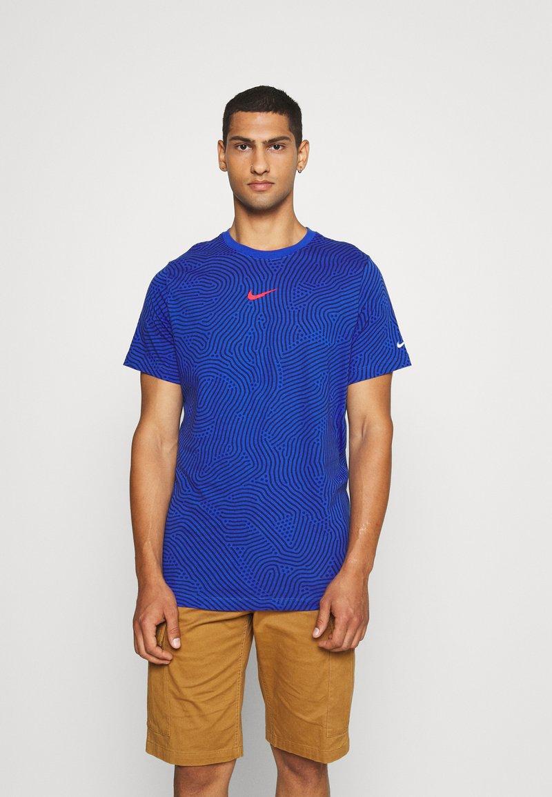 Nike Sportswear - Print T-shirt - game royal