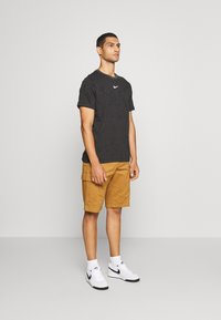 Nike Sportswear - T-shirt con stampa - black - 1