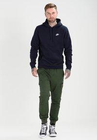 Nike Sportswear - CLUB HOODIE - Hoodie - dark blue - 1