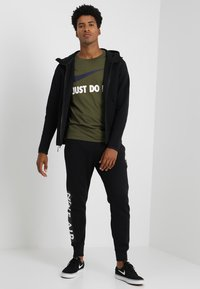 Nike Sportswear - TECH FULLZIP HOODIE - Mikina na zip - black - 1
