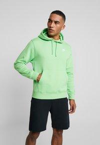 Nike Sportswear - CLUB HOODIE - Luvtröja - green, white - 0