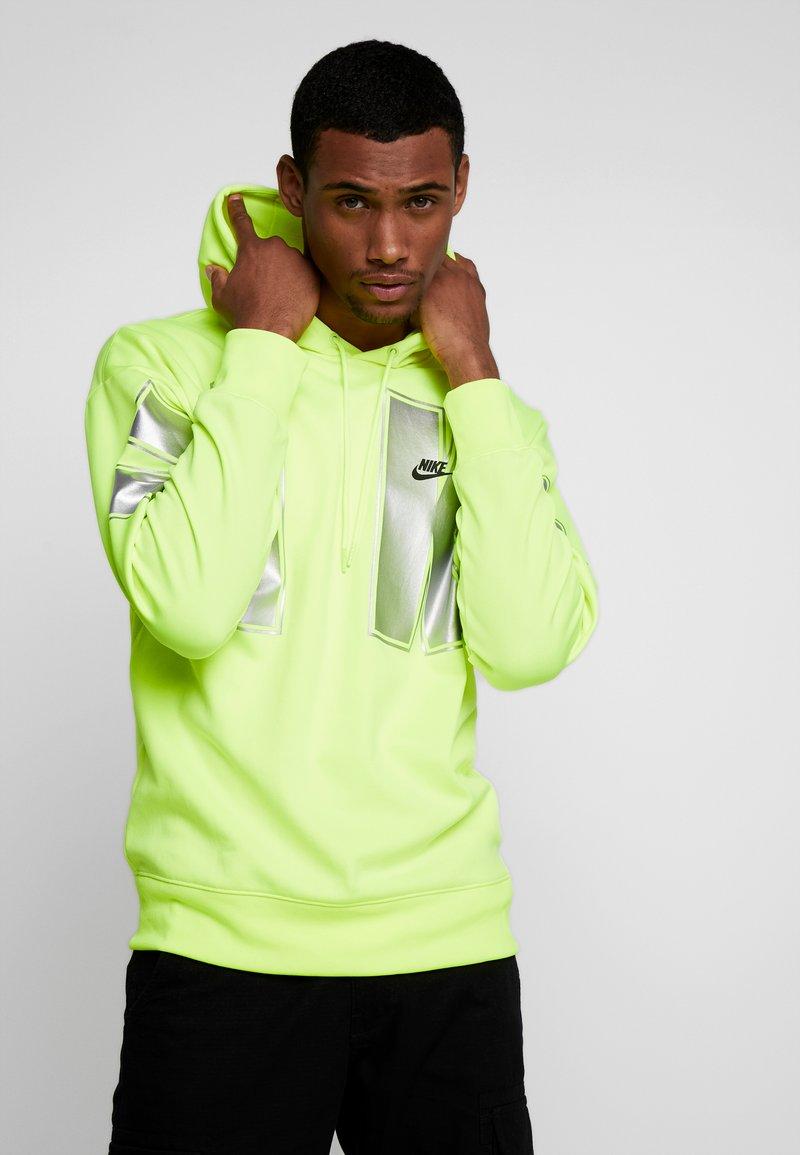 Nike Sportswear - Jersey con capucha - neon green