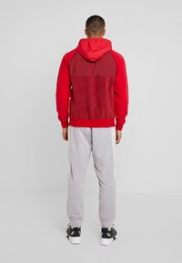 Nike Sportswear - HOODIE WINTER - Fleece jacket - red - 2