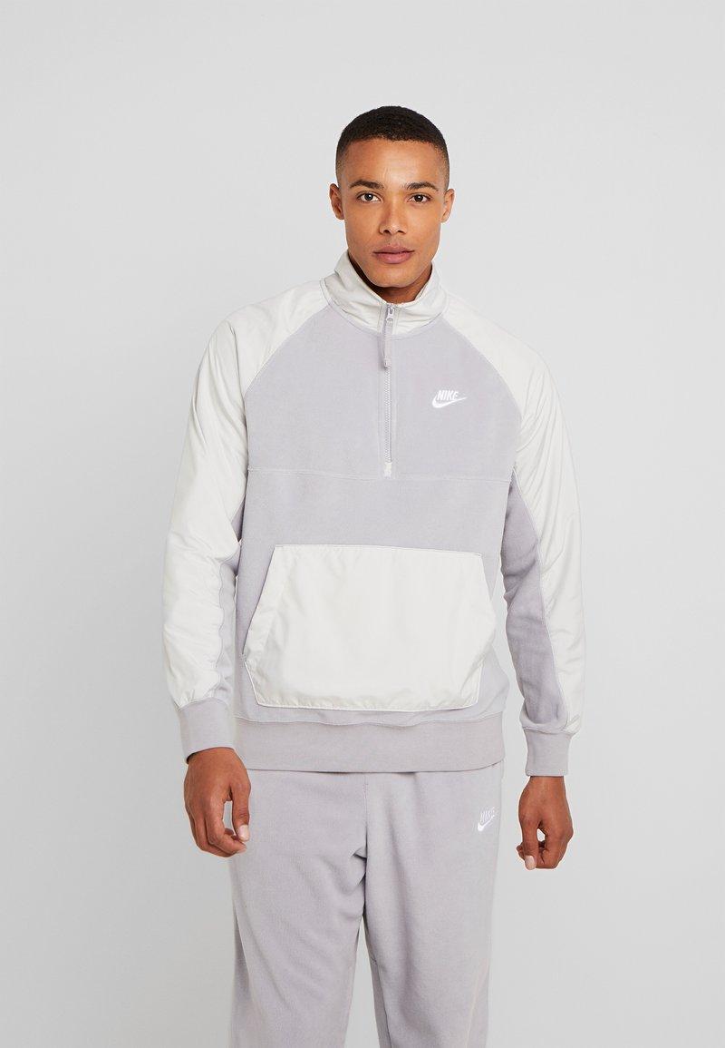 Nike Sportswear - WINTER - Fleece trui - atmosphere grey/light bone/white