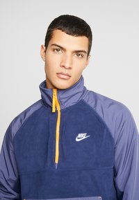 Nike Sportswear - WINTER - Fleece trui - midnight navy/sanded purple/kumquat/white - 4