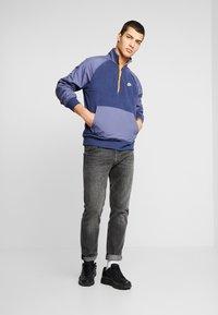 Nike Sportswear - WINTER - Fleece trui - midnight navy/sanded purple/kumquat/white - 1