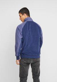Nike Sportswear - WINTER - Fleece trui - midnight navy/sanded purple/kumquat/white - 2