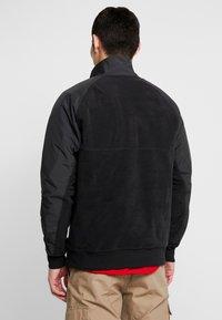 Nike Sportswear - WINTER - Fleece trui - black/off noir/gym red/white - 2