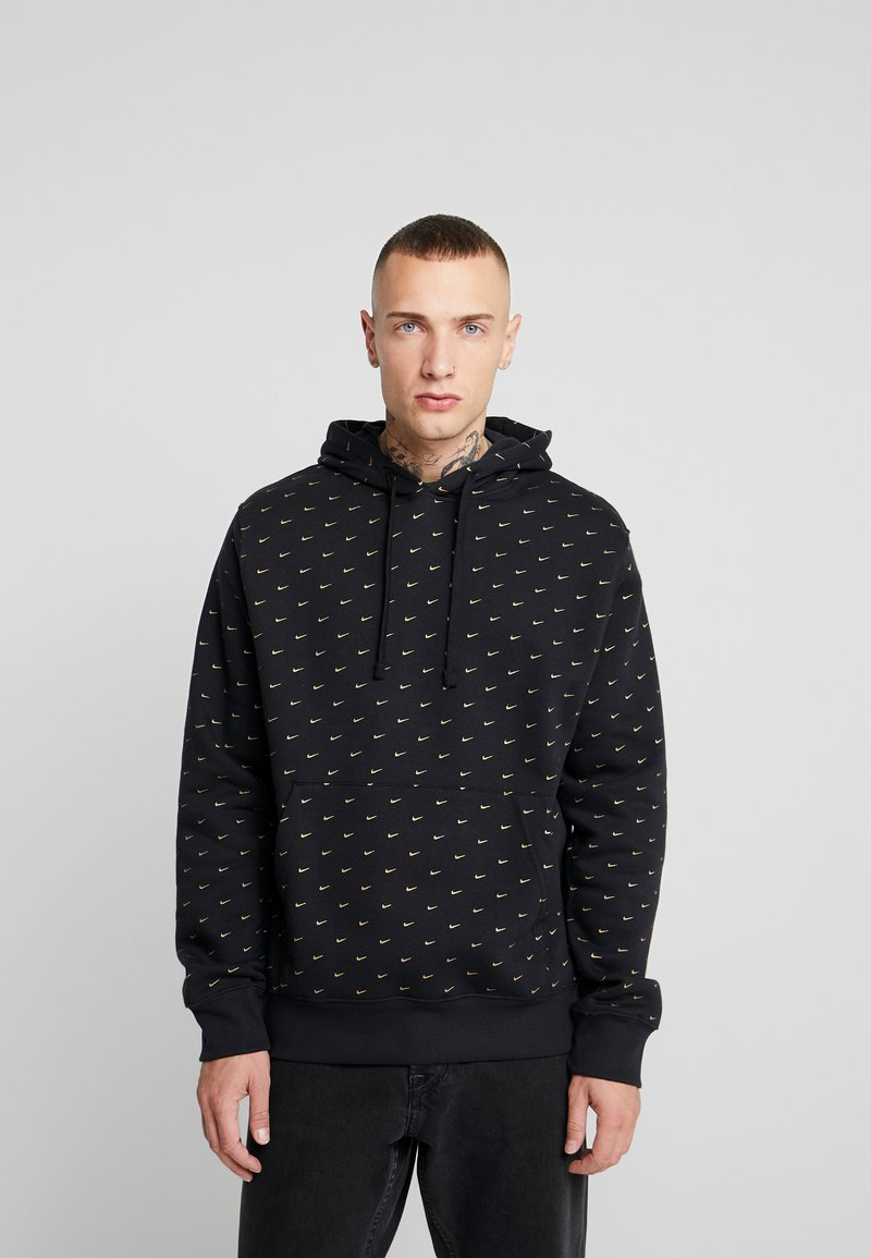 Nike Sportswear - HOODIE - Luvtröja - black/metallic gold