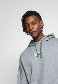 Nike Sportswear - HOODIE  - Hoodie - dark grey heather - 4