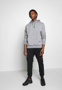Nike Sportswear - HOODIE  - Hoodie - dark grey heather - 1