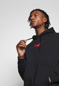 Nike Sportswear - HOODIE  - Sweat à capuche - black - 4
